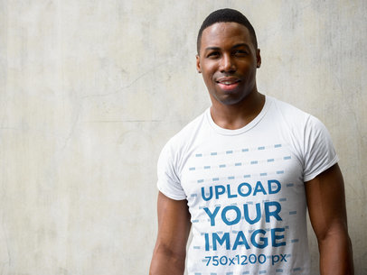 T-Shirt Mockup of a Smiling Man Standing Against a Wall 40412-r-el2