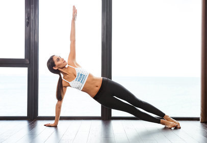 Sports Bra Mockup of a Woman Doing a Side Plank Indoors 36239-r-el2
