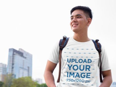 T-Shirt Mockup Featuring a Young Man in the City 40513-r-el2
