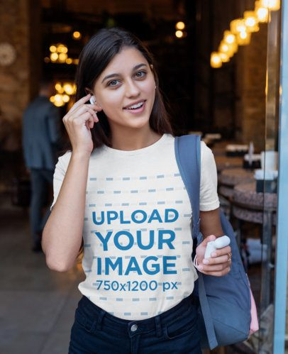 T-Shirt Mockup Featuring a Young Woman Using Wireless Earbuds 40722-r-el2