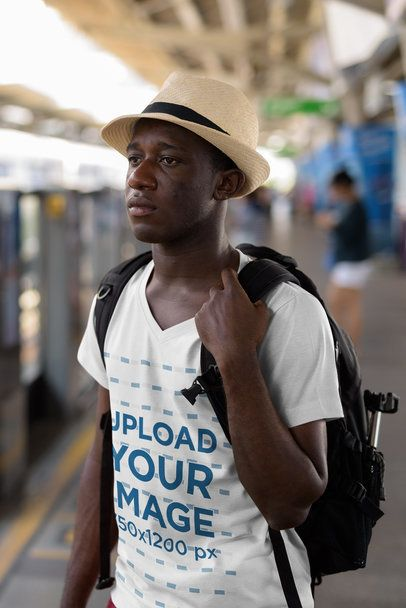 V-Neck Tee Mockup of a Serious Tourist Waiting for the Train 40409-r-el2