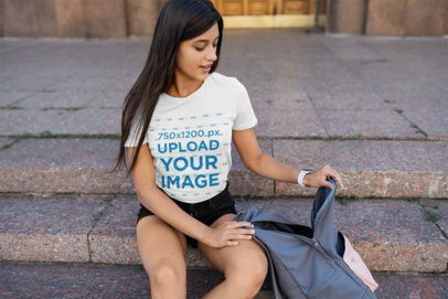 T-Shirt Mockup Featuring a Female College Student Sitting on a Staircase 40889-r-el2