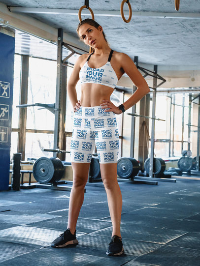 Mockup of a Fit Woman Wearing a Sports Bra and Bike Shorts at a Gym 41465-r-el2