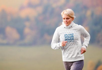 Hoodie Mockup Featuring a Woman Running Outdoors 34877-r-el2