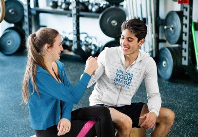 Mockup of a Teenage Boy Wearing a Full-Zip Hoodie at the Gym 35220-r-el2