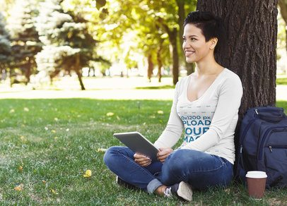 V-Neck Long Sleeve Tee Mockup of a Smiling Woman Sitting in the Park 41601-r-el2