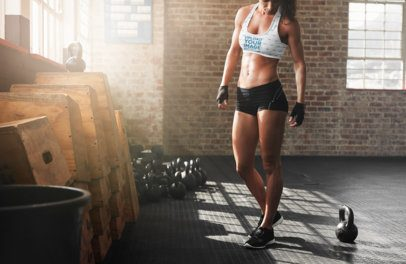 Mockup of an Athletic Woman Wearing a Sublimated Sports Bra in the Gym 35670-r-el2