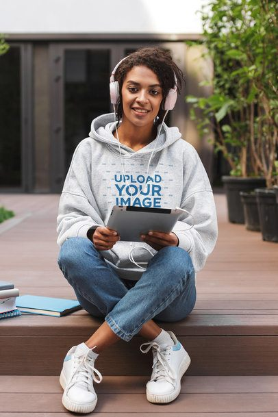 Hoodie Mockup of a Woman Listening to Music on Her Tablet 41123-r-el2
