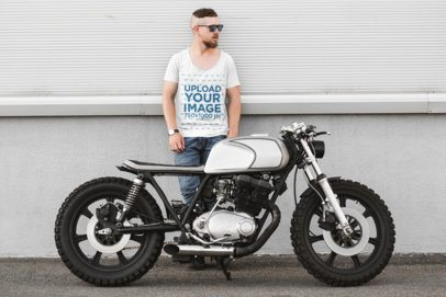 T-Shirt Mockup of a Man Standing Behind a Motorcycle 41676-r-el2