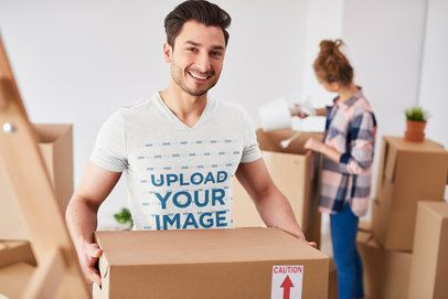 V-Neck T-Shirt Mockup of a Man Packing for a Move 35578-r-el2