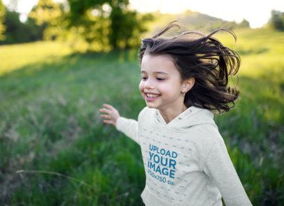 Mockup of a Joyful Girl Wearing a Heather Pullover Hoodie 41350-r-el2