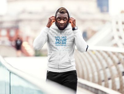 Mockup of a Man Wearing a Heather Hoodie While Walking in the City 41790-r-el2