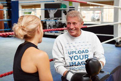 Mockup of a Senior Boxing Coach Wearing a Sweatshirt 39993-r-el2