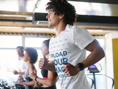 Mockup of a Man with a Heather Activewear Tee Running on a Treadmill 40691-r-el2