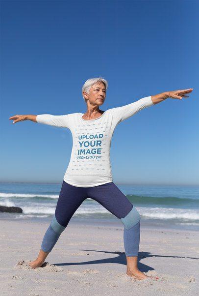Long Sleeve Tee Mockup of a Senior Woman Doing Yoga by the Beach 41565-r-el2