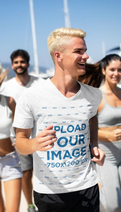 Heather V-Neck T-Shirt Mockup of a Happy Man Running With His Friends 41086-r-el2