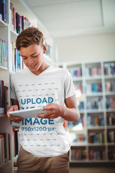 Mockup of a Teenager with a Heathered V-Neck T-Shirt Using a Device at the Library 41578-r-el2