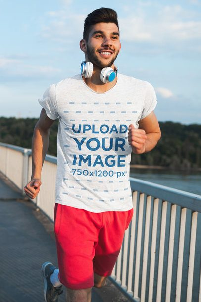 T-Shirt Mockup Featuring a Young Man Running Outdoors 41034-r-el2