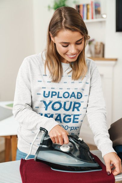 Sweatshirt Mockup Featuring a Woman Ironing 40574-r-el2