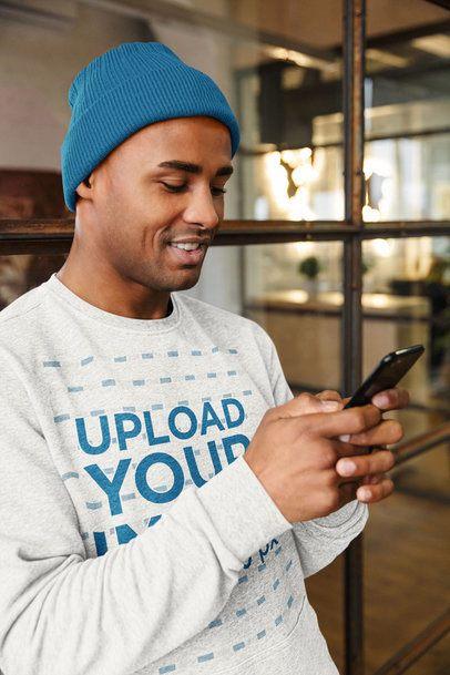 Heathered Sweatshirt Mockup of a Man Checking His Phone 39840-r-el2