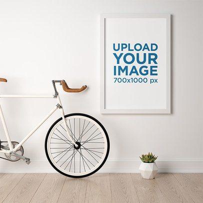 Mockup of a Framed Art Print Hanging Next to a Bike 35644-r-el2