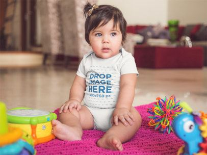 Template Of A Gorgeous White Baby Girl Wearing A Onesie While Sitting At Her House a14048