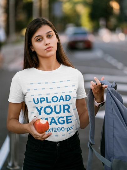 T-Shirt Mockup of a Female Student Holding a Bitten Apple 41402-r-el2