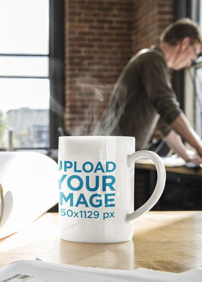Mockup of an 11 oz Coffee Mug Placed on a Work Desk 40989-r-el2