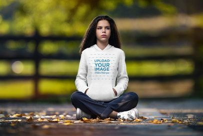 Hoodie Mockup Featuring a Serious Young Woman Sitting on the Floor 4980-el1