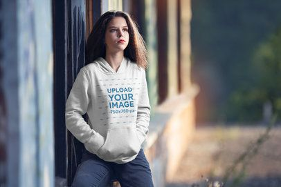 Mockup of a Serious Woman Wearing a Customizable Pullover Hoodie 4982-el1