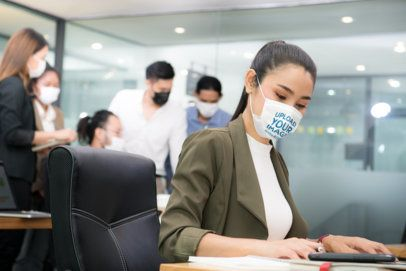 Face Mask Mockup Featuring a Woman Working in an Office 41994-r-el2