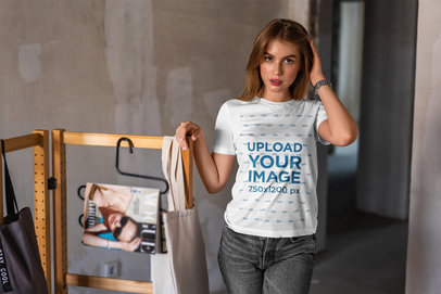 T-Shirt Mockup Featuring a Young Woman Posing in an Atelier 4974-el1