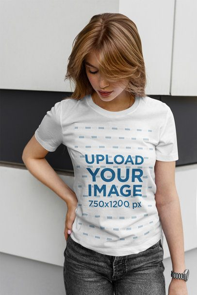Mockup of a Blonde Woman Checking Out Her T-Shirt 4969-el1