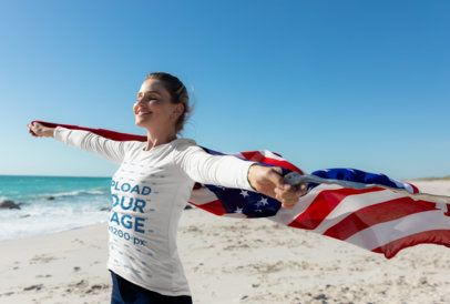 Long Sleeve Tee Mockup of a Woman Holding the US Flag at the Beach 42263-r-el2