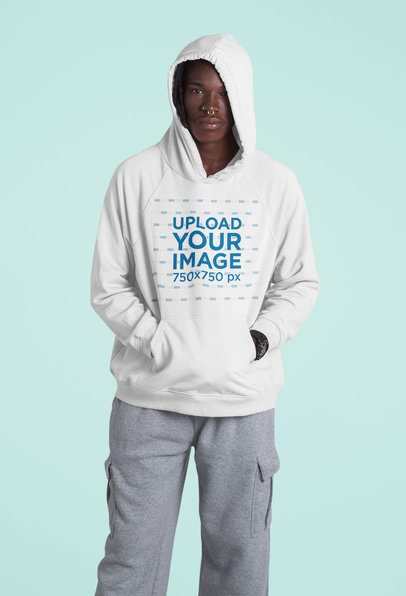 Pullover Hoodie Mockup of a Serious Man Standing in a Studio 42974