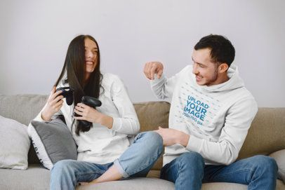 Hoodie Mockup of a Man Playing Video Games with His Wife 42610-r-el2