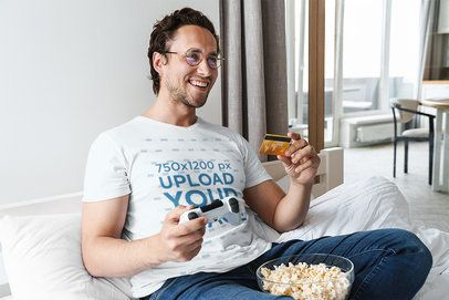 T-Shirt Mockup of a Man Chilling Playing Games at Home 42772-r-el2