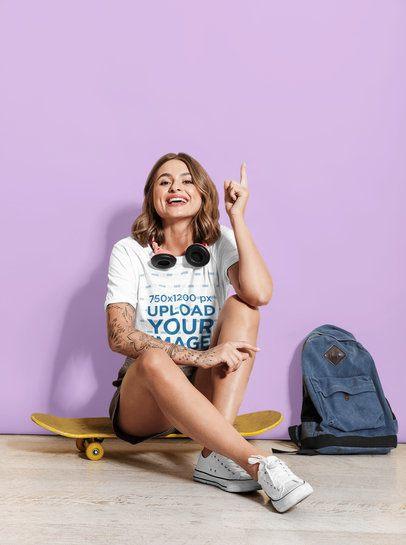 Studio T-Shirt Mockup of a Tattooed Woman Sitting on a Skateboard 43439-r-el2
