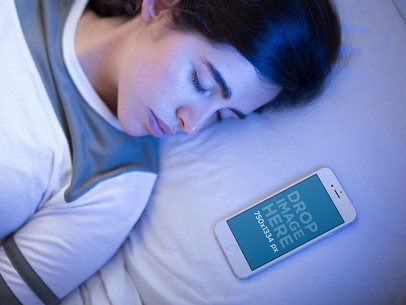 Young White Girl Sleeping with Her White IPhone 6 Besides Her Mockup 14080a