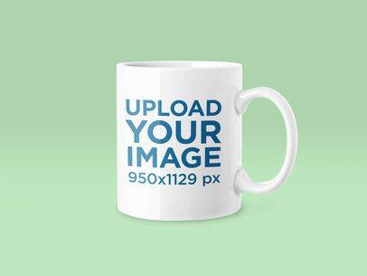 11 oz Mug Mockup Featuring a Plain Color Backdrop 43576-r-el2