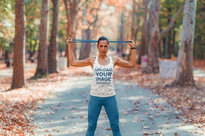 Mockup of a Woman with a Sublimated Tank Top Training in a Park 43657-rel2