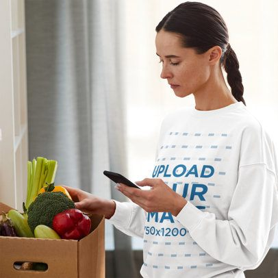 Sweatshirt Mockup of a Woman with a Braid Checking Her Phone at Home 41257-r-el2