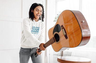 Pullover Hoodie Mockup Featuring a Happy Woman Smashing a Guitar 40850-r-el2