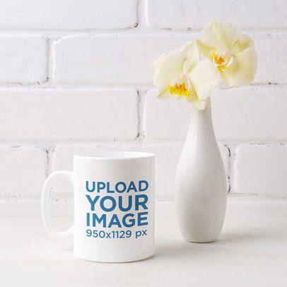Mockup of an 11 oz Mug Next to a Flower Vase 43575-r-el2