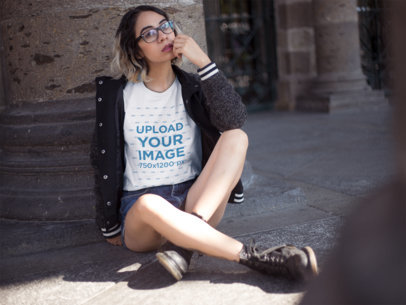 Hipster Hispanic Woman Wearing a Round Neck Tee While Sitting Down Outdoors Mockup a13562