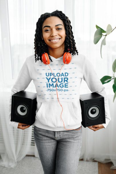 Pullover Hoodie Mockup Featuring a Woman Carrying Two Speakers 39075-r-el2