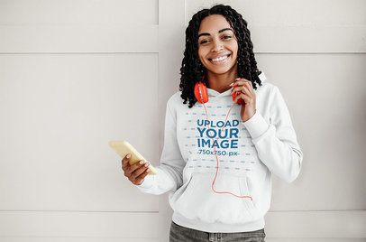 Pullover Hoodie Mockup of a Woman Listening to Music on Her Phone 39074-r-el2