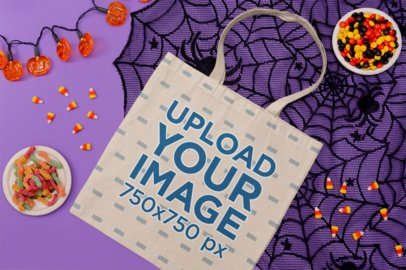 Mockup of a Flat Laid Tote Bag Featuring Halloween Candy 111