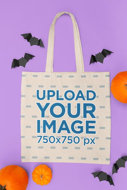 Mockup of a Flat Laid Tote Bag on a Halloween-Decorated Setting m112