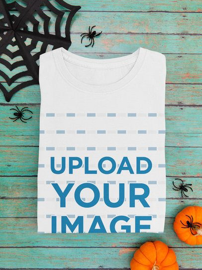 Mockup of a Folded T-Shirt Featuring Halloween Decorations 101